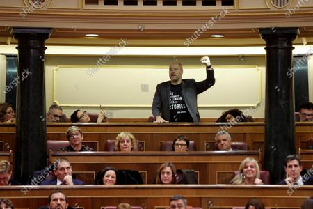 ERC's MP Jordi Salvador i Duch (C) protests during the opening of XVI Legislature in Madrid, Spain, 03 December 2019. A new legislature of Parliament begins in Spain, after general election held last 10 November, with doubts whether acting Prime Minister Pedro Sanchez (unseen) will get enough support to be re-elected.