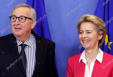 Former European Commission President Jean-Claude Juncker (L) is welcomed by European Commission President Ursula von der Leyen (R) ahead of an official handover ceremony at the European Commission in Brussels, Belgium, 03 December 2019.