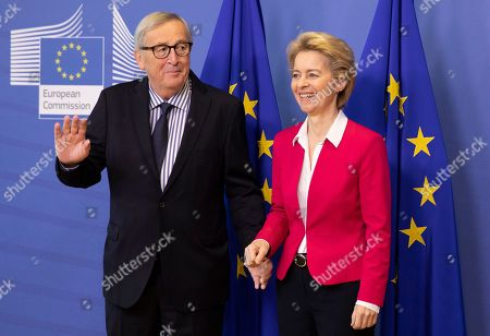 Previous European Commission President Jean-Claude Juncker, left, poses for photographers with European Commission President Ursula von der Leyen, right, prior to an official handover ceremony at EU headquarters in Brussels,. European Commission President Ursula von der Leyen officially took up her position on Dec. 1, 2019