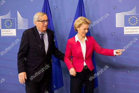 Previous European Commission President Jean-Claude Juncker, left, walks with European Commission President Ursula von der Leyen, right, prior to an official handover ceremony at EU headquarters in Brussels,. European Commission President Ursula von der Leyen officially took up her position on Dec. 1, 2019