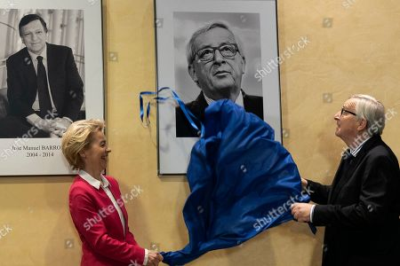 Previous European Commission President Jean-Claude Juncker, right, and current European Commission President Ursula von der Leyen unveil a portrait of Jean-Claude Juncker as they participate in an official handover ceremony at EU headquarters in Brussels, . European Commission President Ursula von der Leyen officially took up her position on Dec. 1, 2019