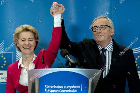 Previous European Commission President Jean-Claude Juncker, right, and current European Commission President Ursula von der Leyen participate in an official handover ceremony at EU headquarters in Brussels, . European Commission President Ursula von der Leyen officially took up her position on Dec. 1, 2019