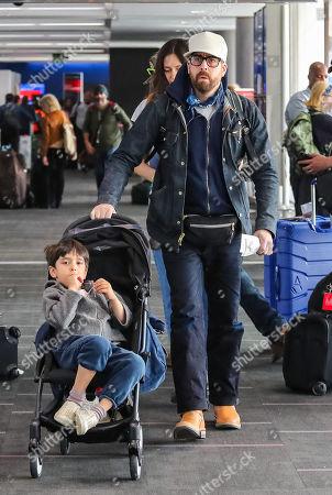 Stock Photo of Adam Goldberg and Roxanne Daner with children Bud and Mazel