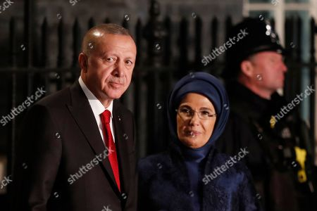 Turkish President Recep Tayyip Erdogan, left, and his wife Emine arrive for a reception for NATO leaders at 10 Downing Street in London,. U.S. President Donald Trump and his NATO counterparts were gathered in London Tuesday to mark the alliance's 70th birthday amid deep tensions as spats between leaders expose a lack of unity that risks undermining military organization's credibility