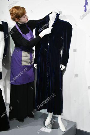 Lot 238  Princess Diana's midnight-blue velvet, by British designer Katherine Cusack, 1986, estimate £20,000-30,000