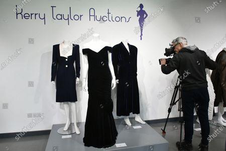 Stock Photo of (L-R) Lot 239, Princess Diana's navy wool day dress by Catherine Walker, circa 1989, estimate £4,000-6,000. Lot 237, Princess Diana's midnight-blue velvet evening gown by Victor Edelstein, estimate £250,000-350,000. Lot 238  Princess Diana's midnight-blue velvet, by British designer Katherine Cusack, 1986, estimate £20,000-30,000