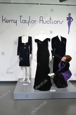 Stock Picture of (L-R) Lot 239, Princess Diana's navy wool day dress by Catherine Walker, circa 1989, estimate £4,000-6,000. Lot 237, Princess Diana's midnight-blue velvet evening gown by Victor Edelstein, estimate £250,000-350,000. Lot 238  Princess Diana's midnight-blue velvet, by British designer Katherine Cusack, 1986, estimate £20,000-30,000