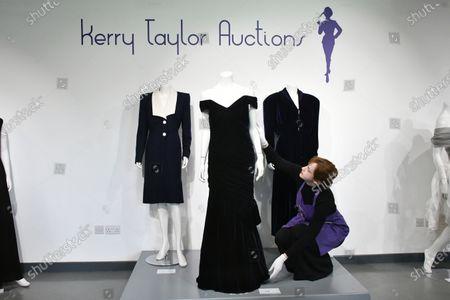 Stock Image of (L-R) Lot 239, Princess Diana's navy wool day dress by Catherine Walker, circa 1989, estimate £4,000-6,000. Lot 237, Princess Diana's midnight-blue velvet evening gown by Victor Edelstein, estimate £250,000-350,000. Lot 238  Princess Diana's midnight-blue velvet, by British designer Katherine Cusack, 1986, estimate £20,000-30,000