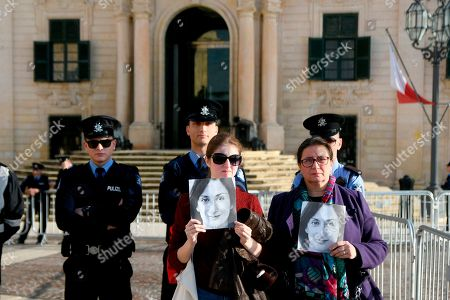 Daphne Caruana Galizia's Sister Mandy Mallia, right, protests outside the office of the Prime Minister at Castille, in Valletta, Malta, as a delegation od European Union lawmakers is visiting the country after an investigation into the murder of leading investigative journalist Daphne Caruana Galizia implicated Prime Minister Joseph Muscat's chief of staff