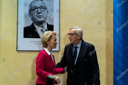 Former European Commission President Jean-Claude Juncker (R) and European Commission President Ursula Von Der Leyen (L) unveil a portrait of Juncker on a wall during an official handover ceremony at the European Commission in Brussels, Belgium, 03 December 2019.