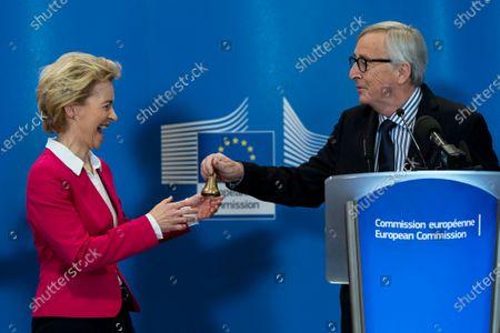 Former European Commission President Jean-Claude Juncker (R) speaks during an official handover ceremony to European Commission President Ursula Von Der Leyen (L) at the European Commission in Brussels, Belgium, 03 December 2019.