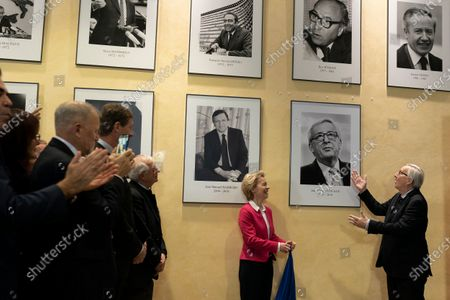 Stock Photo of Former European Commission President Jean-Claude Juncker (R) and European Commission President Ursula Von Der Leyen (L) unveil a portrait of Juncker on a wall during an official handover ceremony at the European Commission in Brussels, Belgium, 03 December 2019.
