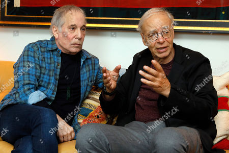 """Stock Picture of Paul Simon, Peter Singer. This photo shows singer-songwriter, Paul Simon, left, and author-philosopher Peter Singer during an interview in New York to promote the new edition of Singer's book """"The Life You Can Save"""