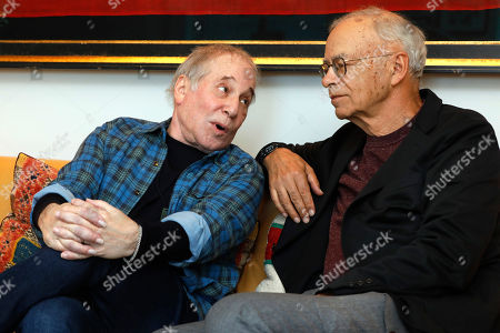 """Paul Simon, Peter Singer. This photo shows singer-songwriter, Paul Simon, left, and author-philosopher Peter Singer during an interview in New York to promote the new edition of Singer's book """"The Life You Can Save"""