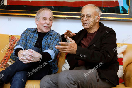 """Stock Photo of Paul Simon, Peter Singer. This photo shows singer-songwriter, Paul Simon, left, and author-philosopher Peter Singer during an interview in New York to promote the new edition of Singer's book """"The Life You Can Save"""
