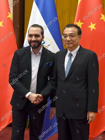 Stock Picture of El Salvador's President Nayib Bukele (L) meets China's Prime Minister Li Keqiang (R) at the Great Hall of the People in Beijing, China, 03 December 2019.