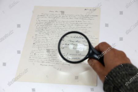 "Meron Eren, co-owner of the Kedem auction house, holds a handwritten letter signed by the Jewish-German physicist Albert Einstein in Jerusalem, Israel, 03 December 2019. The letter was sent by Einstein in June 1950 to a mathematician, Ernst Gabor Strauss during correspondence between them Einstein revealed complex Proof as Part of ""Theory of Everything"". the letter will go up for auction next week at the Kedem Auction House in Jerusalem at a starting price of $20,000."