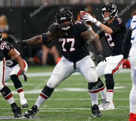 Atlanta Falcons offensive guard James Carpenter (77) looks to block in a week 4 NFL football game against the Tennessee Titans, in Atlanta