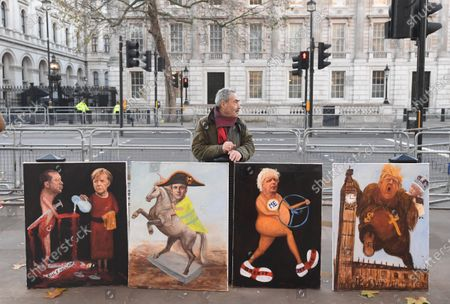 London artist Kaya Mar poses with paintings of NATO leaders (L-R) Turkish President Recep Tayyip Erdogan, German Chancellor Angela Merkel, French President Emmanuel Macron, British Prime Minister Boris Johnson and US President Donald J. Trump outside Downing street on the first day of the NATO Summit in London, Britain, 03 December 2019. NATO countries' heads of states and governments gather in London for a two-day meeting.