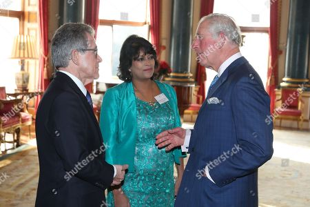 Stock Photo of Chairman of the Queen Elizabeth Prize for Engineering Foundation Lord John Browne of Madingley and Director of the Queen Elizabeth Prize for Engineering Ms Keshini Navaratnam greet Prince Charles as he arrives for the Queen Elizabeth Prize for Engineering at Buckingham Palace