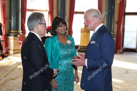 Stock Picture of Chairman of the Queen Elizabeth Prize for Engineering Foundation Lord John Browne of Madingley and Director of the Queen Elizabeth Prize for Engineering Ms Keshini Navaratnam greet Prince Charles as he arrives for the Queen Elizabeth Prize for Engineering at Buckingham Palace