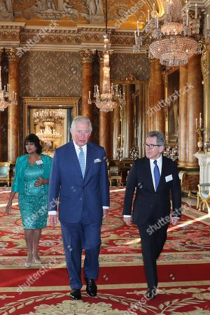 Stock Image of Director of the Queen Elizabeth Prize for Engineering Ms Keshini Navaratnam, Prince Charles and Chairman of the Queen Elizabeth Prize for Engineering Foundation Lord John Browne of Madingley arrive for the Queen Elizabeth Prize for Engineering at Buckingham Palace