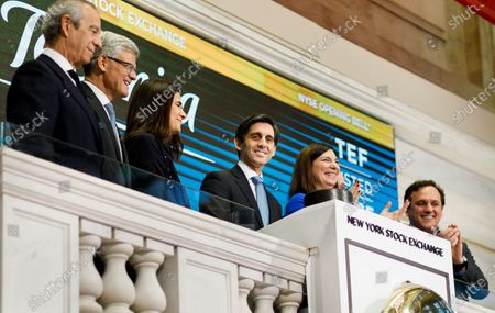 Jose Maria Alvarez-Pallete Lopez (C), the Chief Executive Officer of the Spanish communications company Telefonica SA, rings the opening bell of the New York Stock Exchange in New York, New York, USA, 03 December 2019.