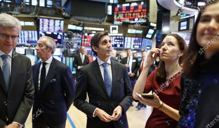 Jose Maria Alvarez-Pallete Lopez (C), the Chief Executive Officer of the Spanish communications company Telefonica SA, visits the floor of the New York Stock Exchange after ringing the opening bell in New York, New York, USA, 03 December 2019.
