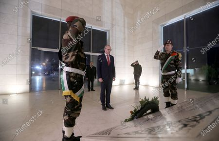 Irish Foreign Minister Simon Coveney (C) visits the grave of the late Palestinian President Yasser Arafat in the West Bank City of Ramallah, 03 December 2019.