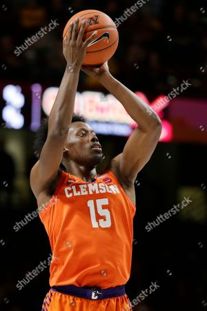 Clemson forward John Newman III shoots against Minnesota during an NCAA basketball game in Minneapolis. Minnesota defeated Clemson 78-60