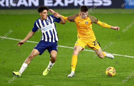 Lewis Collins of Newport County and Haydon Roberts of Brighton and Hove Albion U21s.a