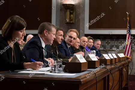 Stock Image of Elizabeth Field, Ryan McCartyh, Thomas Modly, Barbara Barrett, James McConville, Michael Gilday, David Berger, David Goldfein. Government Accountability Office, defense capabilities and management director Elizabeth Field, left, Army Secretary Ryan McCarthy, Army Chief of Staff Gen. James McConville, Acting Navy Secretary Thomas Modly, Chief of Naval Operations Adm. Michael Gilday, Marine Corps Commandant Gen. David Berger, Air Force Secretary Barbara Barrett, and Air Force Chief of Staff David Goldfein testify during a hearing of the Senate Armed Services Committee about about ongoing reports of substandard housing conditions in Washington, on Capitol Hill