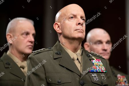 Stock Photo of Marine Corps Commandant Gen. David Berger, center, stands before testifying during a hearing of the Senate Armed Services Committee about about ongoing reports of substandard housing conditions in Washington, on Capitol Hill