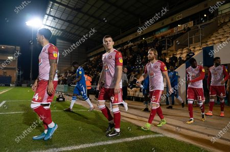 Stock Photo of Jason Cowley of Stevenage and team-mates walk out onto the pitch
