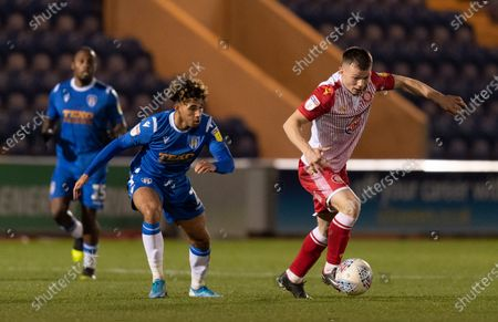 Courtney Senior of Colchester United and Jason Cowley of Stevenage