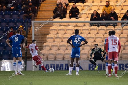 Jason Cowley of Stevenage scores a penalty goal past Ethan Ross of Colchester United, 0-1
