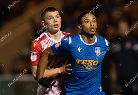 Jason Cowley of Stevenage and Cohen Bramall of Colchester United