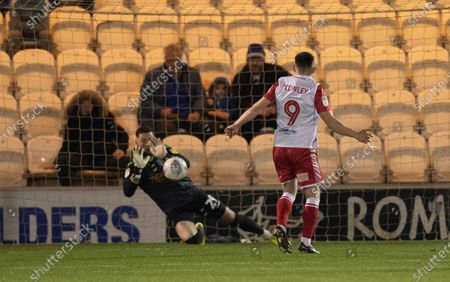 Jason Cowley of Stevenage looks on as Ethan Ross of Colchester United blocks his penalty shot