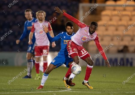 Stock Photo of Brandon Comley of Colchester United and Emmanuel Sonupe of Stevenage
