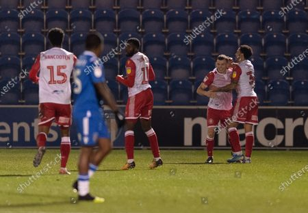 Jason Cowley of Stevenage celebrates his second goal with team-mates, 0-2