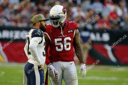 Los Angeles Rams free safety Eric Weddle (32) and Arizona Cardinals outside linebacker Terrell Suggs (56) during an NFL football game, in Glendale, Ariz