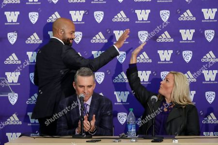 Chris Petersen, Jimmy Lake, Jen Cohen. Washington NCAA college football head coach Chris Petersen, center, applauds as defensive coordinator Jimmy Lake, left, high-fives athletic director Jen Cohen after speaking during a news conference about Petersen's decision to resign and Lake taking over his job, in Seattle. Petersen unexpectedly resigned on Monday, a shocking announcement with the Huskies coming off a 7-5 regular season and bound for a sixth straight bowl game under his leadership. Petersen will coach Washington in a bowl game, his final game in charge
