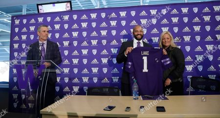 Chris Petersen, Jimmy Lake, Jen Cohen. Washington football head coach Chris Petersen, left, looks on as defensive coordinator Jimmy Lake, center, poses for a photo with athletic director Jen Cohen after a news conference about Petersen's decision to resign and Lake taking over his job, in Seattle. Petersen unexpectedly resigned at Washington on Monday, a shocking announcement with the Huskies coming off a 7-5 regular season and bound for a sixth straight bowl game under his leadership. Petersen will coach Washington in a bowl game, his final game in charge