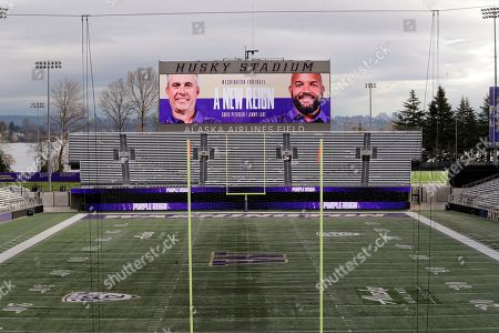 Photos of Washington head coach Chris Petersen, left, and defensive coordinator Jimmy Lake are shown on the scoreboard at Husky Stadium after the announcement that Petersen is leaving his position and that Lake is assuming it, in Seattle. Petersen unexpectedly resigned at Washington on Monday, a shocking announcement with the Huskies coming off a 7-5 regular season and bound for a sixth straight bowl game under his leadership. Petersen will coach Washington in a bowl game, his final game in charge