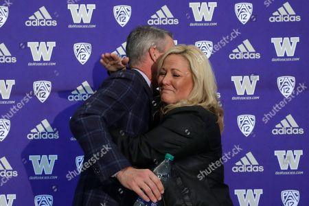 Washington football head coach Chris Petersen, left, is embraced by athletic director Jen Cohen after a news conference about Petersen's decision to resign, in Seattle. Petersen unexpectedly resigned at Washington on Monday, a shocking announcement with the Huskies coming off a 7-5 regular season and bound for a sixth straight bowl game under his leadership. Petersen will coach Washington in a bowl game, his final game in charge. Defensive coordinator Jimmy Lake is being promoted to head coach