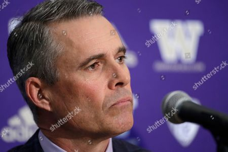 Stock Picture of Washington football head coach Chris Petersen listens during a news conference about his decision to resign at the end of the season, in Seattle. Petersen unexpectedly resigned at Washington on Monday, a shocking announcement with the Huskies coming off a 7-5 regular season and bound for a sixth straight bowl game under his leadership. Petersen will coach Washington in a bowl game, his final game in charge. Defensive coordinator Jimmy Lake is being promoted to head coach