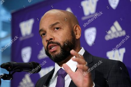 Washington football defensive coordinator Jimmy Lake speaks about taking over the head coaching position from Chris Petersen during a news conference, in Seattle. Petersen unexpectedly resigned at Washington on Monday, a shocking announcement with the Huskies coming off a 7-5 regular season and bound for a sixth straight bowl game under his leadership. Petersen will coach Washington in a bowl game, his final game in charge
