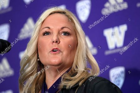 Washington athletic director Jen Cohen speaks during a news conference about football head coach Chris Petersen's decision to resign, in Seattle. Petersen unexpectedly resigned at Washington on Monday, a shocking announcement with the Huskies coming off a 7-5 regular season and bound for a sixth straight bowl game under his leadership. Petersen will coach Washington in a bowl game, his final game in charge. Defensive coordinator Jimmy Lake is being promoted to head coach
