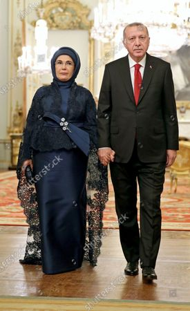 Turkish President Recep Tayyip Erdogan (R) arrives with his wife Emine (L) during a reception at Buckingham Palace, London, as leaders gather to mark 70 years of the alliance during the NATO Summit in London, Britain, 03 December 2019. NATO countries' heads of states and governments gather in London for a two-day meeting.