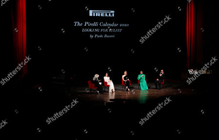 From left, Whoopi Goldberg, British actress Claire Foy, British model Mia Goth, American model Yara Shahidi and photographer Paolo Roversi attend the 2020 Pirelli Calendar event in Verona, Italy